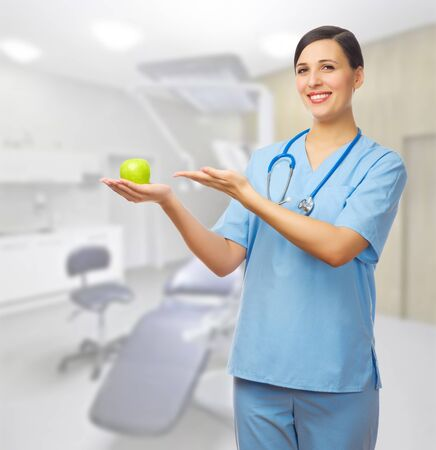 Doctor with apple medical office photo
