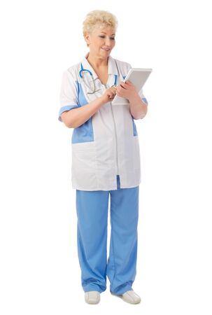 Mature doctor with tablet PC isolated photo