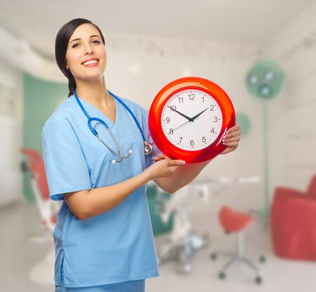 Doctor with clock at medial office photo