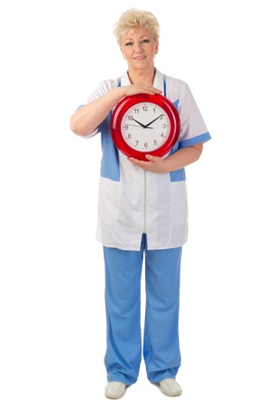 Mature doctor with clock isolated Stock Photo - 19203520