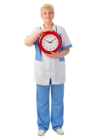 Mature doctor with clock isolated Stock Photo - 19340544