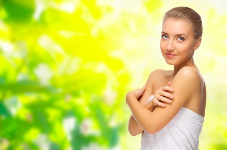 Young healthy girl on floral spring background photo