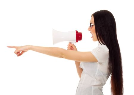 Girl with megaphone shows pointing gesture isolated photo
