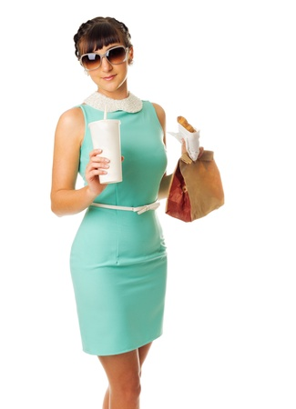 Glamorous girl in turquoise dress holds snacks isolated photo