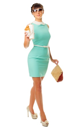 Glamorous girl with plastic cup and snacks isolated photo