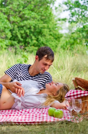 Young couple on picnic at forest photo