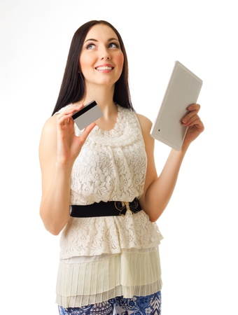 Young girl with credit card and tablet PC isolated photo