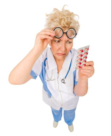 funny doctor: Mature funny doctor with pills isolated Stock Photo