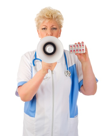 Mature doctor with megaphone and pills isolated photo