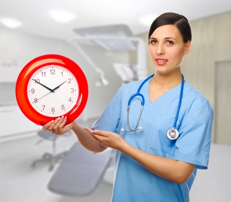 Doctor with clock at medical office photo