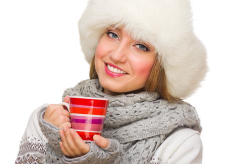 Young girl with mug isolated photo