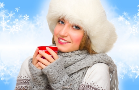 Young girl with mug on winter background photo