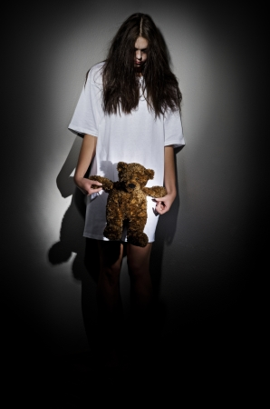 Crazy girl with teddy bear photo