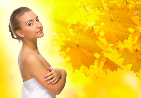 Young healthy girl on autumnal background photo