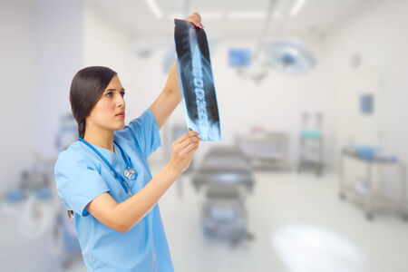 Young doctor with x-ray at medical office photo