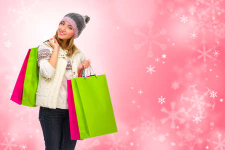 Young girl with bags on winter red background Stock Photo - 23171889