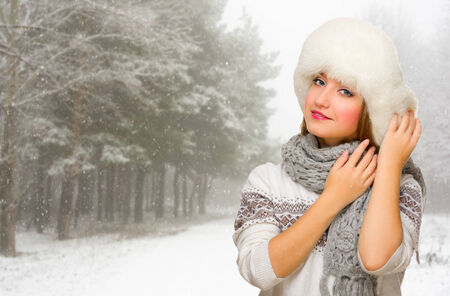 Young smiling girl at winter forest photo