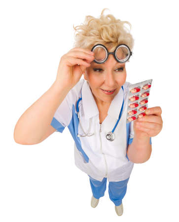 Funny mature doctor in nerd glasses with pills isolated photo
