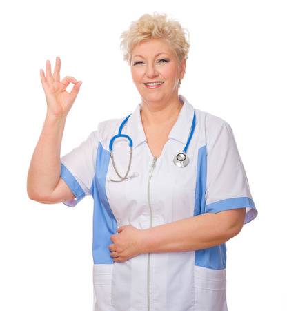 Mature doctor shows ok gesture isolated photo