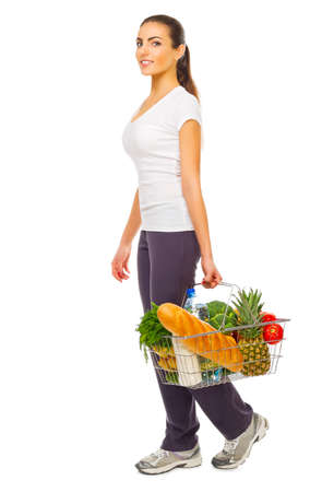 Young girl with shopping basket isolated photo