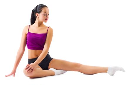 Young sporty girl doing gymnastic exercises isolated photo