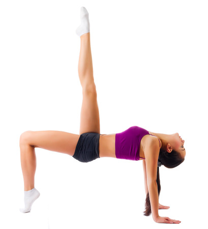 Young sporty girl doing gymnastic exercises isolated photo