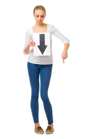 Young girl with arrow down placard isolated photo