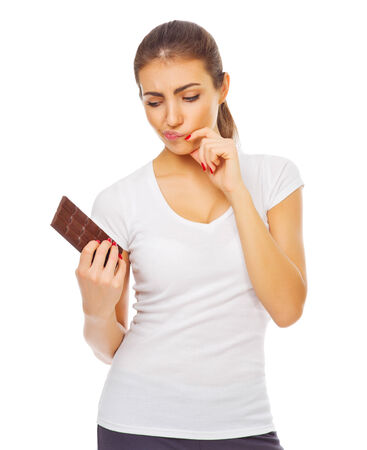 Young healthy woman with chocolate isolated photo