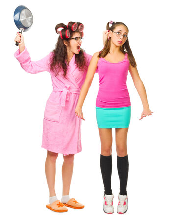 Anger mother with pan screams to her daughter isolated photo