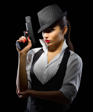 Young girl with gun on black photo
