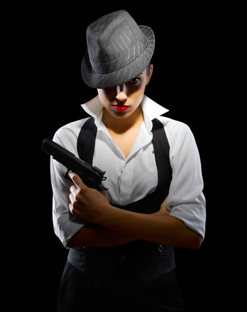 Young girl with gun and hat photo