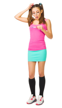 Worried schoolgirl with pregnansy test isolated photo