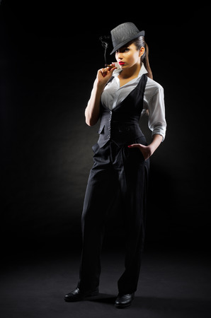 Girl with cigar on black photo