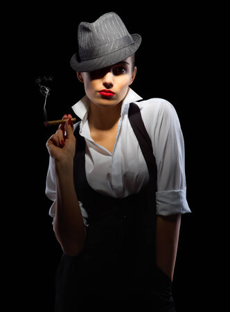 Young woman with hat and cigar isolated photo