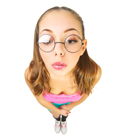 funny glasses: Funny schoolgirl with nerd glasses isolated Stock Photo