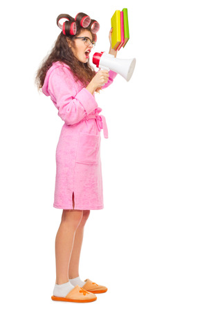 Funny housewife with books and megaphone isolated photo
