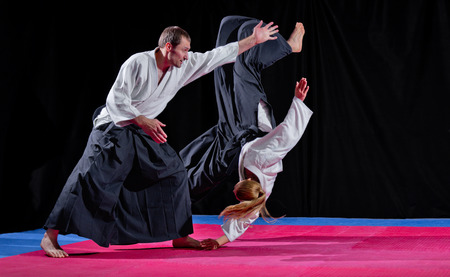 karate female: Two martial arts fighters on black Stock Photo