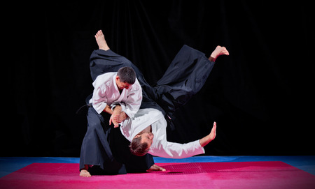 Two martial arts fighters on black Stok Fotoğraf