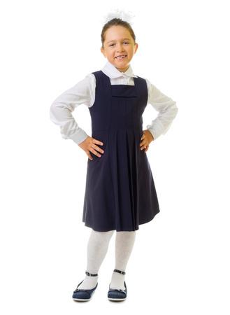 zapatos escolares: Pequeña colegiala aislado en blanco