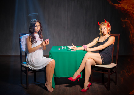 insidious: Angel and devil playing cards at room