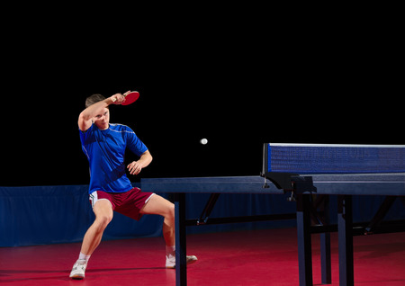Table tennis player isolated on black Stock Photo