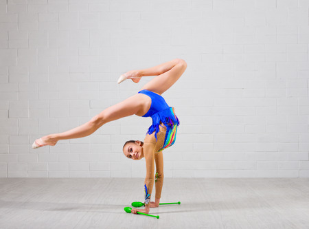 Young girl is engaged in art gymnastics photo
