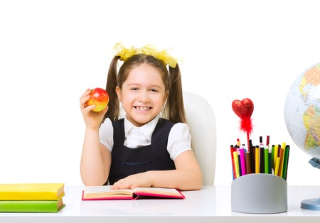 Schoolgirl at the table isolated photo
