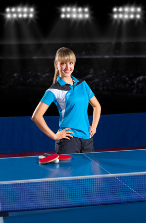 Young girl table tennis player at sport hall photo
