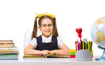 schoolgirl uniform: Schoolgirl at her desk isolated