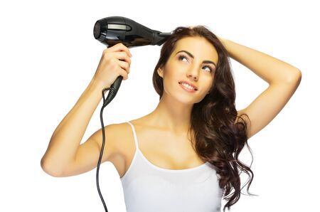 brown hair: Young healthy girl with hair dryer isolated Stock Photo