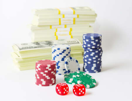 Gambling chips dices and heap of dollars isolated photo