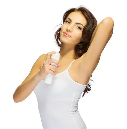 Jong meisje met deodorant geïsoleerde