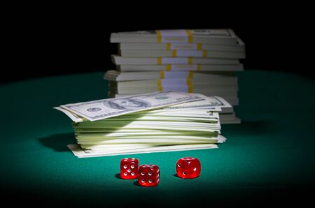 Dices and dollars on green table photo