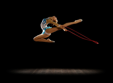 Girl engaged art gymnastics isolated